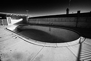 Empty Pool Prints - empty abandoned swimming pool at old motel on the strip Las Vegas Nevada USA Print by Joe Fox