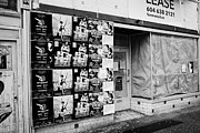 Shopfront Prints - empty downtown store for lease covered in posters Vancouver BC Canada Print by Joe Fox