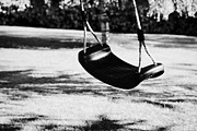 Child Swinging Art - Empty Plastic Swing Swinging In A Garden In The Evening by Joe Fox