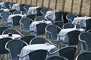 Outdoor Cafes Metal Prints - Empty restaurant seats and tables Metal Print by Sami Sarkis
