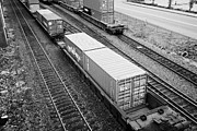 Goods Prints - evergreen and tex freight shipping containers on rail cars freight train goods tracks Vancouver BC C Print by Joe Fox