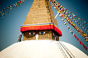 Tibetan Buddhism Posters - Eye of Tibetan stupa Boudnath and Buddhist Prayer Flags  Poster by Raimond Klavins
