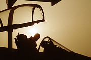 Iraq Prints Prints - F-15C Eagle aircraft is silhouetted against the sun Print by Amy Denson