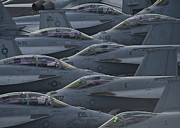 Fa18 Super Hornets Sit On The Flight Deck Of The Aircraft Carrier Uss Enterprise  Print by Paul Fearn