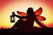 Fantasy Photos - Fairy With Firey Red Wings Holding Lit Lantern In Silhouette by Kriss Russell