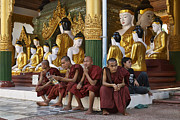 Birma Prints - faithful Buddhist monks siiting around Buddha Statues in SHWEDAGON PAGODA Print by Juergen Ritterbach
