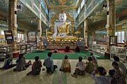 Birma Prints - faithful Buddhists praying at sitting Buddha in golden Ponnya Shin Pagoda Print by Juergen Ritterbach
