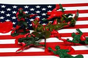Bloodshed Prints - Fallen Toy Soliders on American Flag Print by Amy Cicconi