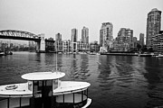 Water Taxi Framed Prints - False Creek water taxi burrard street bridge and waterfront apartment buildings on a wet overcast da Framed Print by Joe Fox