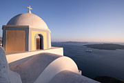 Greek Icon Posters - Famous orthodox church in Santorini Greece at sunset Poster by Matteo Colombo