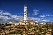 Ilha De Faro Framed Prints - Faro Lighthouse Framed Print by Nigel Hamer