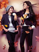 Preteen Posters - Fashionably dressed boy and teenage girl under falling autumn le Poster by Oleksiy Maksymenko