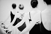 Ballerinas Framed Prints - Female Teenage Ballet Students Holding On To A Ballet Barre At A Ballet School In The Uk Framed Print by Joe Fox