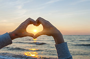 Heart Photos - Fingers heart framing ocean sunset by Elena Elisseeva