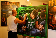 Tim Tebow Paintings - Finishing Touches To The Original Painting For The Tim Tebow Foundation Celebrity Golf Classic 2013 by Sports Art World Wide John Prince