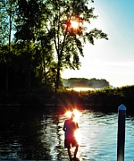Reflections Of Sun In Water Prints - Fisherman in Sunfire Print by Judy Via-Wolff