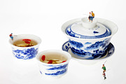 Blue And White Porcelain Posters - Fishing on tea cups little people on food series Poster by Paul Ge