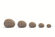 Neutral Colours Framed Prints - Five Pebbles against White Background Framed Print by Natalie Kinnear