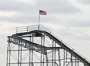 Jetstar Photo Metal Prints - Flag mounted on Seaside Heights Roller Coaster Metal Print by Melinda Saminski