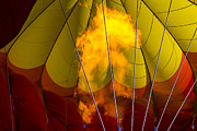 Red Balloons Prints - Flames heating up hot air balloon Print by Garry Gay