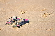 Thongs Framed Prints - Flip Flops on the Sand Framed Print by Kaye Menner