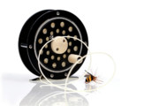 Black Posters - Fly Fishing Reel with Fly Poster by Tom Mc Nemar