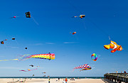 Kites Photos - Flying Kites at St Augustine Beach Pier by Michelle Wiarda