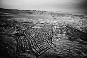 Urban City Areas Photos - flying over boulder city Nevada USA by Joe Fox