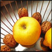 Food And Beverage Art - Food still life - yellow apple and brown walnuts - beautiful warm colors by Matthias Hauser