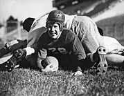 College Sports Prints - Football Player Gets Tackled Print by Underwood Archives
