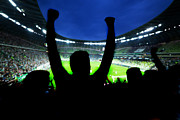 Victory Field Photo Prints - Football soccer fans support their team and celebrate Print by Michal Bednarek