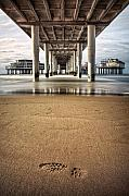 Piers Prints - Footprints in the Sand Print by David Bowman