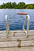 Diving Photos - Footprints on dock at summer lake by Elena Elisseeva