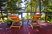 Wood Porch Posters - Forest cottage deck and chairs Poster by Elena Elisseeva