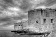 Fortified Castle Walls Against A Dramatic Sky Print by Oscar Gutierrez