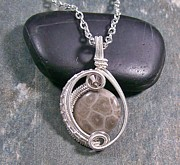 Featured Jewelry - Fossil Coral and Swarovski Crystal Woven Circle Pendant by Heather Jordan