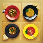 Soup Bowl Framed Prints - Four Dishes Of Different Food Framed Print by Ron Nickel