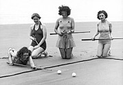 Recreational Pool Prints - Four Girls Playing Sand Pool Print by Underwood Archives