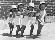 Beach Activities Framed Prints - Four Little Girls Having Fun Framed Print by Underwood Archives