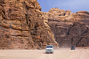 Four Wheel Drive Vehicles At Wadi Rum Jordan Print by Robert Preston