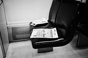 On Paper Photos - free metro paper discarded on seat on board canada line skytrain Vancouver BC Canada by Joe Fox