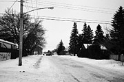 Winter Roads Posters - frozen streets covered in snow pleasant hill Saskatoon Saskatchewan Canada Poster by Joe Fox