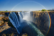 Livingstone Posters - Full-circle rainbow at victoria falls Poster by Nicole Cambre