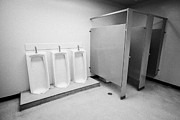 Cubicle Framed Prints - full length urinals and cubicles in mens toilet of High school canada north america Framed Print by Joe Fox