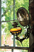 Green Glass Framed Prints - Furniture - Lamp - An oil lantern Framed Print by Mike Savad