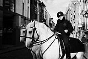 Garda Posters - Garda Siochana Mounted Police On Horseback In Temple Bar Dublin Republic Of Ireland Poster by Joe Fox