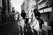 Garda Posters - Garda Siochana Mounted Police On Horseback Taking Notes In Temple Bar Dublin Republic Of Ireland Poster by Joe Fox