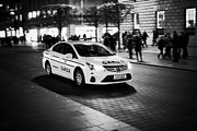 Patrol Car Prints - Garda Siochana Patrol Car Driving Along Oconnell Street At Night Dublin Republic Of Ireland Print by Joe Fox