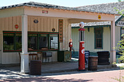 Log Cabins Prints - Gas Station at Historical Park Print by Ruth  Housley