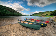 Green Canoe Prints - Geirionydd Lake Print by Adrian Evans
